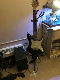 Black and white stratocaster electric guitar Somerville, 02145