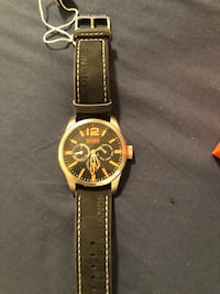 round gold-colored chronograph watch with brown leather strap Calgary, T3H 3S4