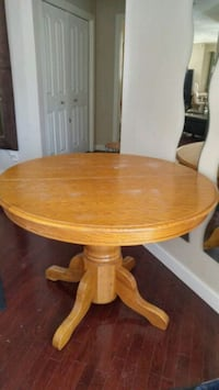 round brown wooden pedestal table Calgary, T3J 0A1