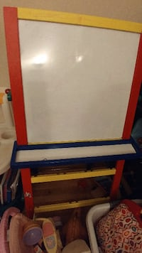 white, yellow, red and blue easel board Montreal