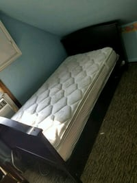 quilted white mattress and black wooden bed frame Norwalk, 06854