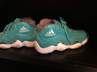 pair of teal Nike Air Foamposite shoes Eugene, 97404