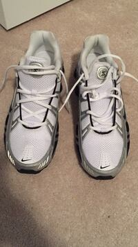 pair of white Nike running shoes Ajax, L1T