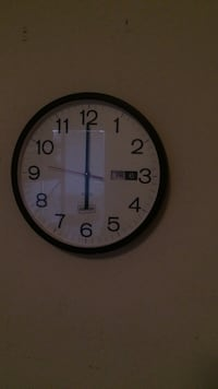 black and white analog wall clock