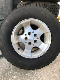 5- Goodyear Wrangler tires 235/75/15 with Jeep Rims