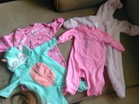 toddler's four white, teal, and pink footie pajamas