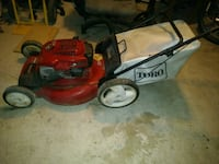 red and black push mower Del Valle, 78617