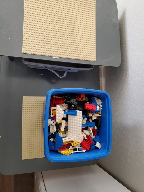 Lego table plus bucket of legos