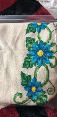 green, blue, and white knitted textile