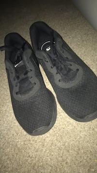 pair of black Nike running shoes 64 km