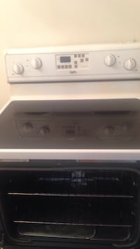 White and black induction range oven Toronto, M9M 2B1