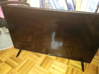 black flat screen TV with remote Pointe-Claire, H9R 6A7