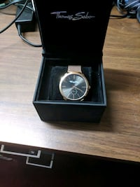 round silver-colored chronograph watch with link b Toronto, M9N 1B1