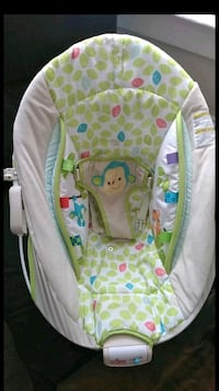 baby's white and green bouncer El Paso, 79902