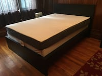 Brown wooden bed frame with white mattress Boston, 02115
