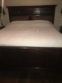 brown wooden bed frame with white mattress Dollard-des-Ormeaux, H9A 2L9