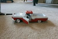white and red truck toy 15 km