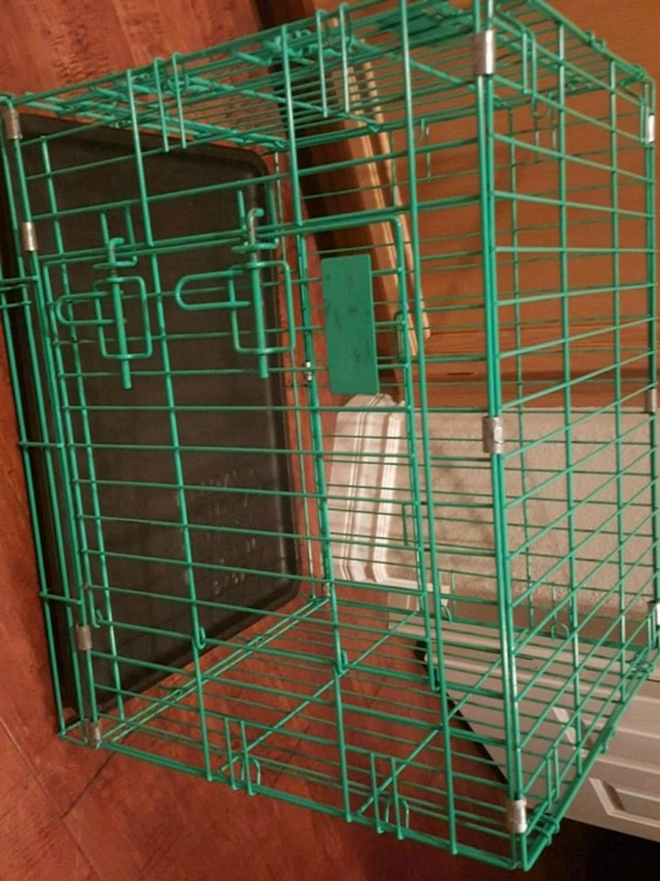 green metal folding pet cage