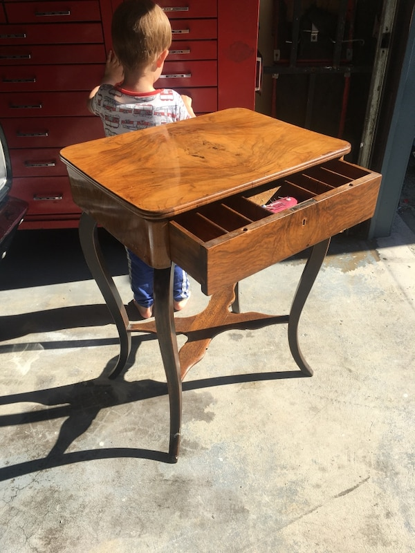 brown wooden end table with drawer