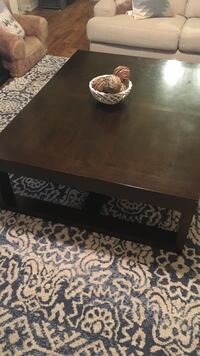 Large brown wooden coffee table Waukee, 50263