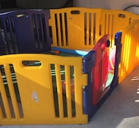 toddler's yellow and blue play pen