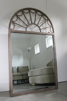 High-end mirror with textured metal frame