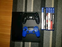 Sony PS4 Konsole mit Controller und Game Cases