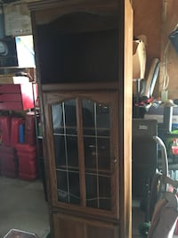 Oak Entertainment Cabinet with lights in top cabinet. Glass front.