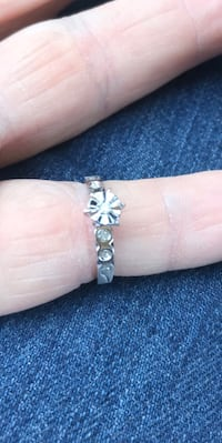 14k white gold engagement ring with a 0.10 carat diamond surrounded by smaller diamonds in the band.  Size 6.  Retails for $1826.  Perfect for the woman you are going to marry. Great for a gift for the one you love for birthdays or Christmas     As always Fullerton, 92832