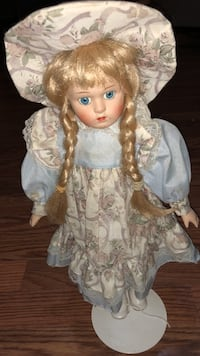 white and brown floral dressed porcelain doll Charleston, 25309