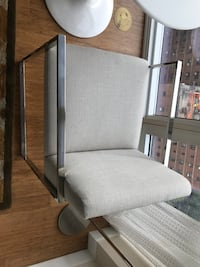 gray fabric padded rolling armchair New York