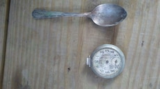 silver spoon; silver round analog pocket watch
