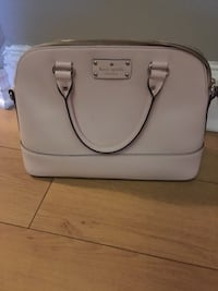 Beautiful pastel pink Kate Spade purse. Includes long strap for over the shoulder or across body.