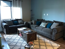 Grey Couches with decorative pillows