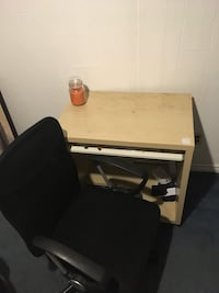 Brown wooden desk with black rolling chair Brantford, N3P 1A5