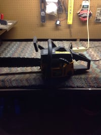 black and yellow chainsaw