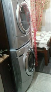 gray front-load clothes washer and dryer set 549 km
