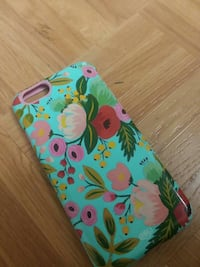 teal, red, pink, yellow, and green floral print iPhone case