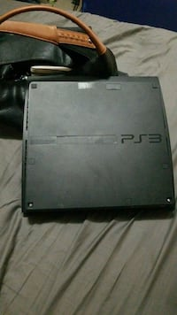 black Sony PS3 game console Sylvan Lake, T4S 0G4