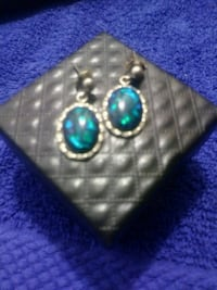 pair of silver-colored pendant earrings with blue gemstone Denver