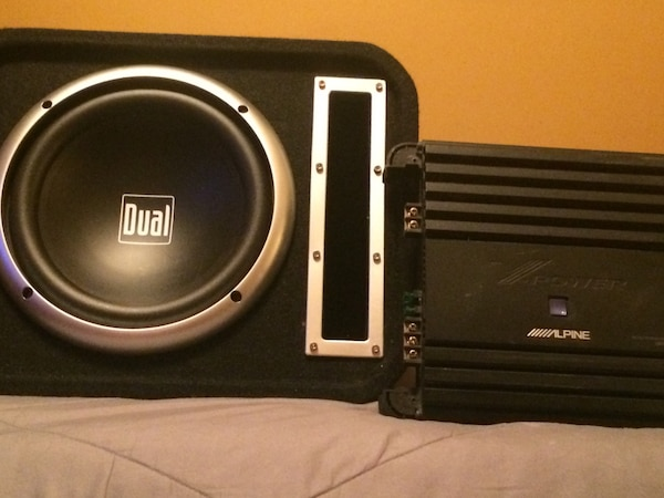 black and silver Dual subwoofer with black Alpine power amplifier