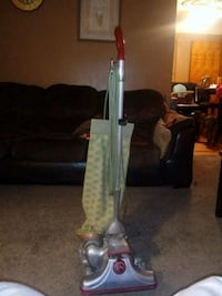 red and gray upright vacuum cleaner 252 mi