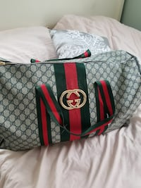 grey, green, and red Gucci monogram duffle bag