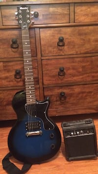 black and blue electric guitar with amplifier