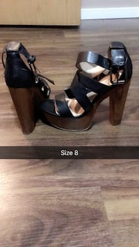 pair of black leather open-toe heeled sandals Calgary, T1Y 3R3