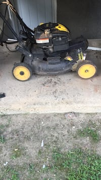 Black and yellow push mower