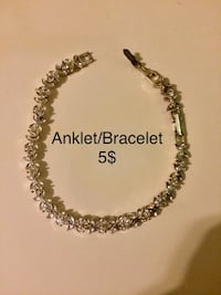 silver-colored chain necklace with text overlay Hamilton, L8L 6M8
