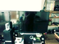 black flat screen TV with32 inch Clayton, 27520