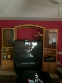 brown wooden TV hutch with flat screen television San Antonio, 78217