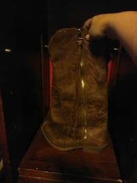 pair of brown leather side-zip cowboy boots